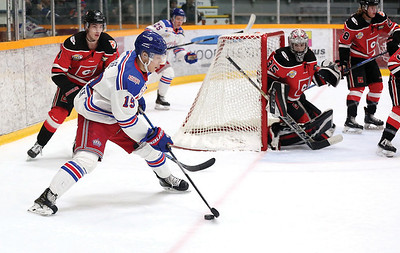 Prince George Spruce Kings forward Chong Min Lee looks to make a play against the Merritt Centennials on Wednesday night at Rolling Mix Concrete Arena. Citizen Photo by James Doyle      Novmber 28, 2018
