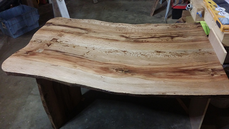 This office desk is made from an oak tree that grew on Craig Lozzi's property and will be used in his at-home massage business.