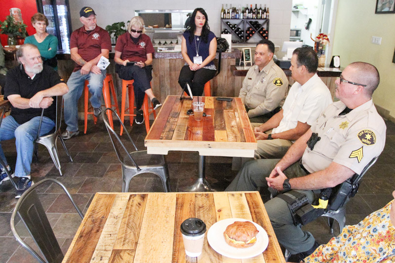 Law enforcement officers from the San Diego County Sheriff's Department Fallbrook substation participate in a coffee with the community event at Brooktown Kitchen & Coffee, Nov. 7. In attendance are substation commander Lt. Rick Lopez, third from right; Detective Sgt. Patrick Yates, second from right, and Sgt. Bill Munsch, far right.