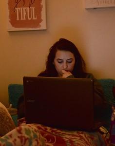 Molly Burdette, Senior, studies in her room before fall break.
