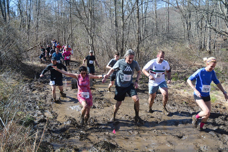 Mudflats runners struggle to stay upright on the deep slippery mud. (photo by Chris Reinke)