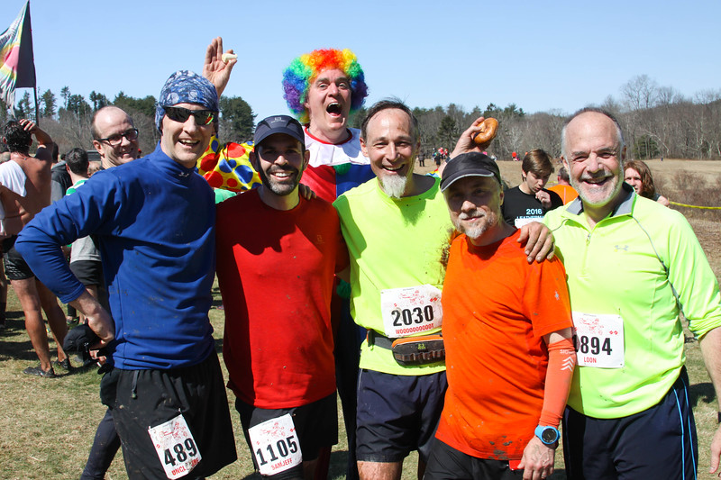 "The pre-run crew of the Leatherman Harriers takes a well deserved break after not only checking the course at 6:30am but also running it with the rest of the 1,360 runners at 9am. Joe Cloidt, Jeff Koenig, Alan Wegener, Lee Willett, and Jeff Thompson are in front, with Jim ""the Clown"" Funk photobombing in the back. (Photo by Bram Wegener)"