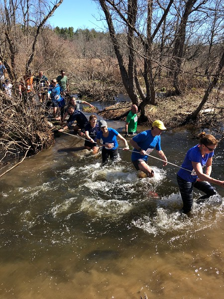 Runners cross the river at Splashdown near the finish of the Loop (photo by Renee Janso)