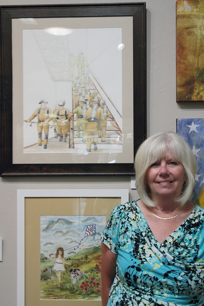 """Watercolor artist and Fallbrook resident Cathy Coffey is the winner of first place in the 2-dimensional category with her watercolor """"The Ascension"""", seen upper left."""