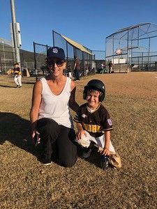 Kyle's preschool teacher Ms. Campion came out to watch him play.