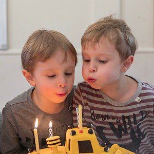 Sebastian (left) and Orlando (right) Blowing Out Candles