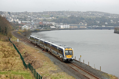 Northern Ireland Railways '3000' Class DMU no 3004 runs alongside the River Foyle as it departs Derry with the 1038 to Belfast Great Victoria Street (11/04/2018)