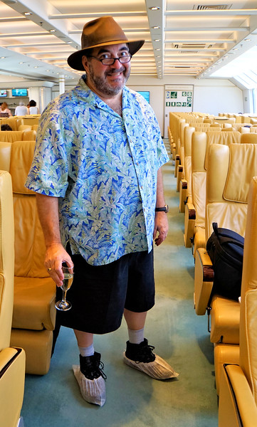William in his mandatory shoe covers on the ferry between Montevideo and Buenos Aires