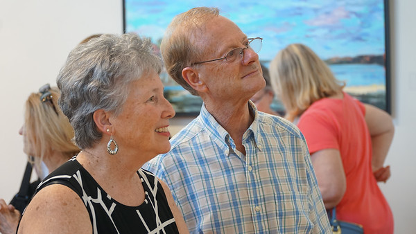 Dr. Charles Langley (right) and Ann Smevlog-Langley enjoying the gallery.