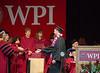 Benjamin receiving his diploma