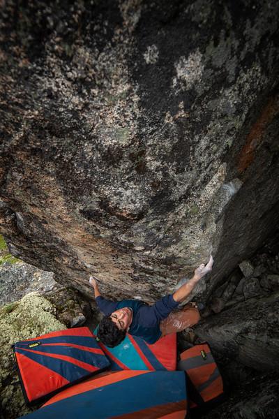 David pulls through a new V7-ish problem above Archangel Valley.