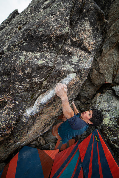 David pulls through a new V7-ish problem above Archangel Valley.