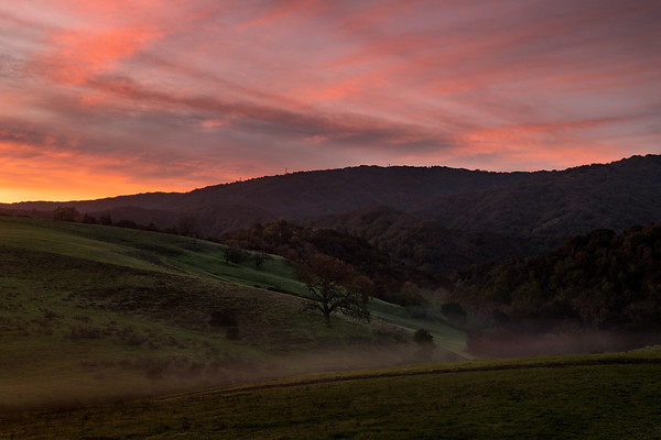 Sunrise with hills and trees