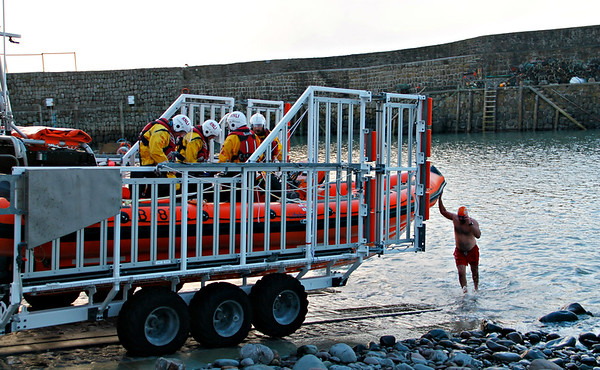 The local RNLI crew kindly waited until this courageous swimmer had come out of the water.