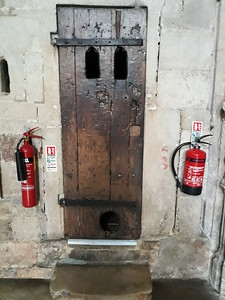 As tallow was used in the clock, a cat was 'employed' to kill mice and rats - the hole at the bottom of the door is it's medieval 'cat flap'