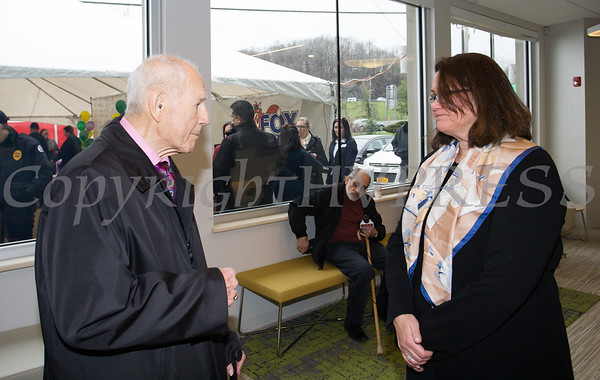 NYS Senator William Larkin talks with PalliaTech NY President Michelle Bodner as Curaleaf held a ribbon cutting ceremony in celebration of their grand opening in Newburgh on April 19, 2018. Hudson Valley Press/CHUCK STEWART, JR.