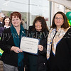 Orange County Chamber of Commerce President Lynn Allen Cione presented a certificate of recognition to Curaleaf during their grand opening celebration in Newburgh on April 19, 2018. Hudson Valley Press/CHUCK STEWART, JR.