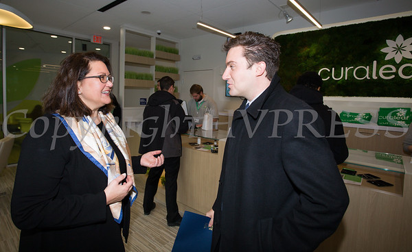 NYS Assemblyman James Skoufis talks with PalliaTech NY President Michelle Bodner as Curaleaf held a ribbon cutting ceremony in celebration of their grand opening in Newburgh on April 19, 2018. Hudson Valley Press/CHUCK STEWART, JR.