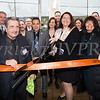 Michelle Bodner cuts the ribbon as Curaleaf held a ribbon cutting ceremony in celebration of their grand opening in Newburgh on April 19, 2018. Hudson Valley Press/CHUCK STEWART, JR.