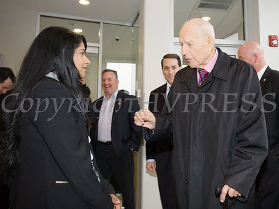 Curaleaf Dispensary Manager Teena Varghese greets NYS Senator William Larkin as Curaleaf held a ribbon cutting ceremony in celebration of their grand opening in Newburgh on April 19, 2018. Hudson Valley Press/CHUCK STEWART, JR.