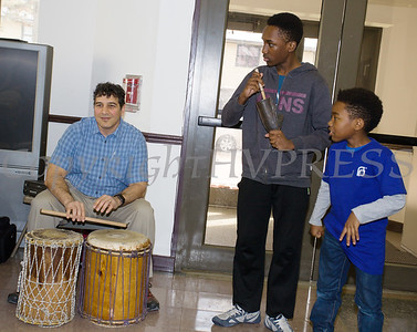 African Drummer Baba Kazi Oliver instructs participants on various instruments as the Healthy Community Outreach Project presented a kickoff celebration in the Community Room at the Mullins apartments on Saturday, February 3, 2018. Hudson Valley Press/CHUCK STEWART, JR.