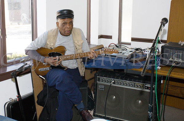 Guitar player Greg Sharp performs as the Healthy Community Outreach Project presented a kickoff celebration in the Community Room at the Mullins apartments on Saturday, February 3, 2018. Hudson Valley Press/CHUCK STEWART, JR.