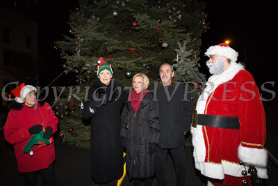 Deputy Mayor Regina Angelo, Mayor Judy Kennedy and Santa Claus thank the couple who donated this years tree as the City of Newburgh welcomed its Broadway tree during its official dedication and tree lighting ceremony on Wednesday, December 14, 2016. Hudson Valley Press/CHUCK STEWART, JR.