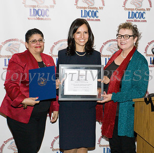 Sonia Ayala, left, and Mary Olivera, right, present Jennifer Echevarria, center, with the Leadership Award during the Latino Democratic Committee of Orange County Fifteenth Annual Fall Dinner Dance at Cafe Internationale in Newburgh, NY on Saturday, October 13, 2018. Hudson Valley Press/CHUCK STEWART, JR.