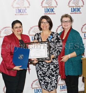 Sonia Ayala, left, and Mary Olivera, right, present Shannon Wong, center, with a certificate of recognition during the Latino Democratic Committee of Orange County Fifteenth Annual Fall Dinner Dance at Cafe Internationale in Newburgh, NY on Saturday, October 13, 2018. Hudson Valley Press/CHUCK STEWART, JR.