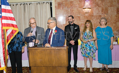 Peter Gonzalez reads a proclamation for Jose Carrion who received the Hoy Award during Latinos Unidos of the Hudson Valley 13th Annual Hispanic Heritage Cultural Celebration at Anthony's Pier 9 in New Windsor, NY on Friday, October 12, 2018. Hudson Valley Press/CHUCK STEWART, JR.