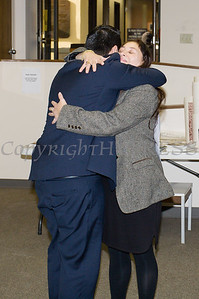 Newly elected Orange County Legislator for District 4, Kevindaryan Lujuan embraces his mother Monica after he took the oath of office on Tuesday, January 2, 2018. Hudson Valley Press/CHUCK STEWART, JR.