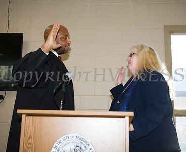 Newburgh City Court Judge Hon. E. Loren Williams adminsters the oath of office to Patricia Sofolkes (Ward 4) during the induction ceremony for newly elected members of the Newburgh City Council on Monday, January 1, 2018. Hudson Valley Press/CHUCK STEWART, JR.