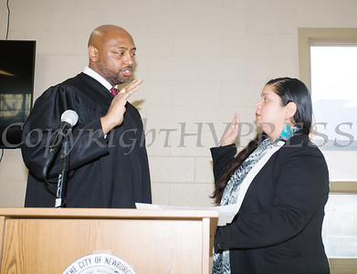 Newburgh City Court Judge Hon. E. Loren Williams adminsters the oath of office to Karen Mejia (Ward 1) during the induction ceremony for newly elected members of the Newburgh City Council on Monday, January 1, 2018. Hudson Valley Press/CHUCK STEWART, JR.