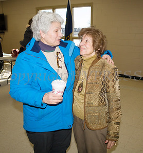 Former Councilmember Genie Abrams and former Deputy Mayor Regina Angelo embrace following the induction ceremony for the newly elected members of the Newburgh City Council on Monday, January 1, 2018. Hudson Valley Press/CHUCK STEWART, JR.