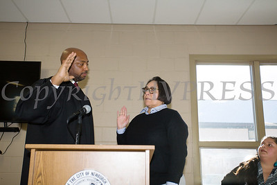 Newburgh City Court Judge Hon. E. Loren Williams adminsters the oath of office to Ramona Monteverde (Ward 2) during the induction ceremony for newly elected members of the Newburgh City Council on Monday, January 1, 2018. Hudson Valley Press/CHUCK STEWART, JR.