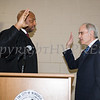 Newburgh City Court Judge Hon. E. Loren Williams adminsters the oath of office to Jonathan Jacobson (Ward 3) during the induction ceremony for newly elected members of the Newburgh City Council on Monday, January 1, 2018. Hudson Valley Press/CHUCK STEWART, JR.