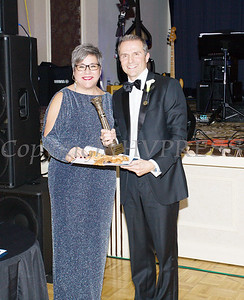 Dr. Gerard J. Galarneau accepts the pillar award for Distinguished Service on behalf of Orange Regional Medical Center from Linda S. Muller during Cornerstone Family Healthcare's 19th Annual Pillars of the Community Gala held at Anthony's Pier 9 on Saturday, November 3, 2018. Hudson Valley Press/CHUCK STEWART, JR.