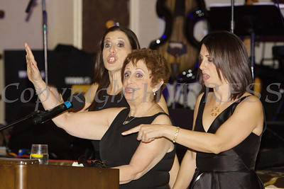 Raena Endick Korenman, flanked by her daughters, received the Lifetime Achievement Award during Cornerstone Family Healthcare's 19th Annual Pillars of the Community Gala held at Anthony's Pier 9 on Saturday, November 3, 2018. Hudson Valley Press/CHUCK STEWART, JR.