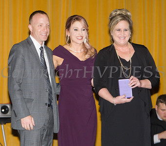 """Kellyann Kostyal-Larrier, center, presented Monroe-Woodbury Rotary Club with the Mildred Warren """"Good-Neighbor"""" Award as Safe Homes of Orange County celebrated its 32nd Anniversary with a Celebration of Hope Gala on Friday, November 2, 2018. Hudson Valley Press/CHUCK STEWART, JR."""