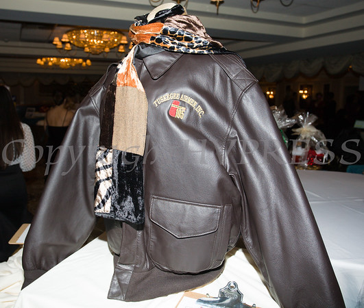 There were plenty of auction items available during the 20th Annual Tuition Assistance Awards Celebration of the Major General Irene Trowell-Harris Chapter of the Tuskegee Airmen, held on Saturday, February 3, 2018 at Anthony's Pier 9 in New Windsor, NY. Hudson Valley Press/CHUCK STEWART, JR.