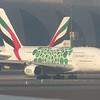 Expo-2020 green liveried Emirates Airlines Airbus A380 A6-EEW at Dubai International Airport on a Gatwick flight, 07.12.2018.