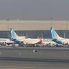 A trio of FlyDubai Boeing 737 aircraft at Dubai International Airport including A6-FEI and A6-FEO, 07.12.2018.
