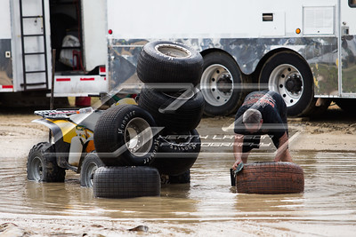 "Crew member washing tires in ""Lake East Bay"""