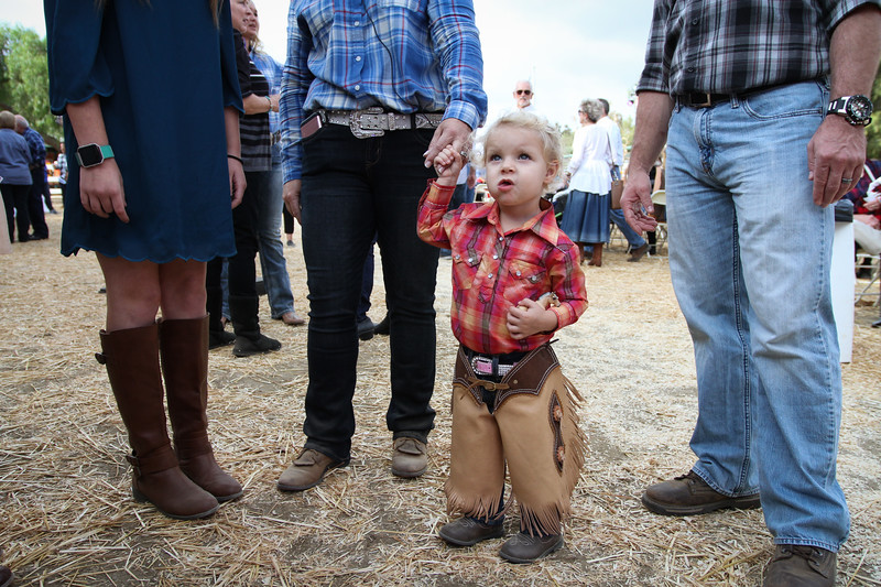 Kadence Siewert, 2, stands with her family at the REINS Country <br /> Hoedown.
