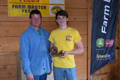 Vincent Baiamonte, right, won the 1st place in 9th-12th grade shooter award at the 2018 Louisiana Farm Bureau Sporting Clays Shootout. Pictured with him is Louisiana Farm Bureau DeSoto Parish President Joey Register.