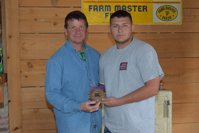 Zachery skipper, right, won the 3rd place in 9th-12th grade shooter award at the 2018 Louisiana Farm Bureau Sporting Clays Shootout. Pictured with him is Louisiana Farm Bureau DeSoto Parish President Joey Register.