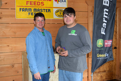 Connor Arthur, right, won the 2nd place in 9th-12th grade shooter award at the 2018 Louisiana Farm Bureau Sporting Clays Shootout. Pictured with him is Louisiana Farm Bureau DeSoto Parish President Joey Register.