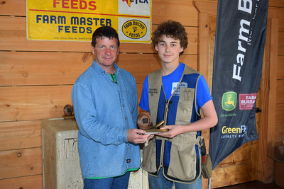 Charlie Waller, right, won the 1st place in 4th-8th grade shooter award at the 2018 Louisiana Farm Bureau Sporting Clays Shootout. Pictured with him is Louisiana Farm Bureau DeSoto Parish President Joey Register.
