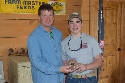 Joshua Ogden, right, won the 3rd place in 4th-8th grade shooter award at the 2018 Louisiana Farm Bureau Sporting Clays Shootout. Pictured with him is Louisiana Farm Bureau DeSoto Parish President Joey Register.