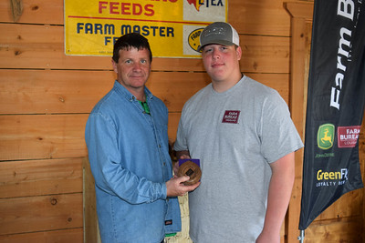 Josh Colvin, right, won the 2nd place in 4th-8th grade shooter award at the 2018 Louisiana Farm Bureau Sporting Clays Shootout. Pictured with him is Louisiana Farm Bureau DeSoto Parish President Joey Register.